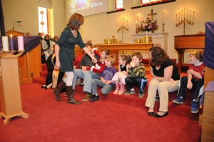 A time for children is often a part of the 11:00 service. Ms. Katie is delivering the message.